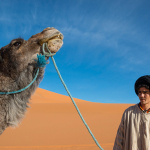 Man-and-camel-Sahara-Desert-Morocco